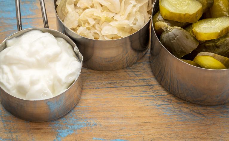 Yogurt, sauerkraut and pickled gherkins