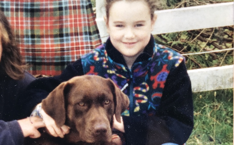 Clemmie with a dog during a period of taking steroids